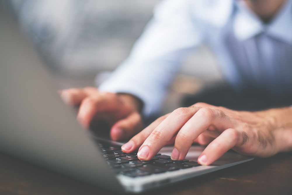 man-typing-on-laptop